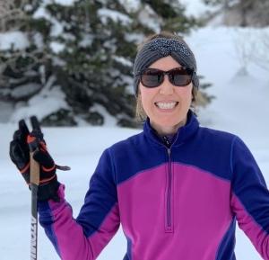 photo of kathryn dennett carpenter as she cross-country skis